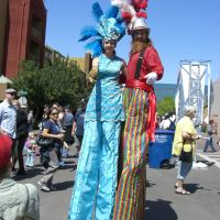 """(Extra) ordinary""  - Stilt Walkers - WPC"