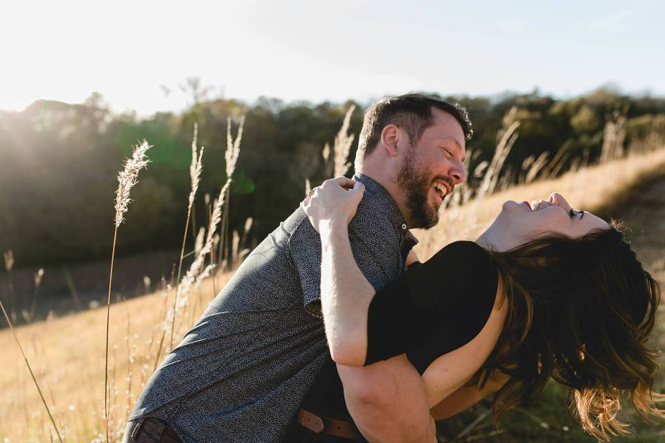 engaged couple laughing together at omaha engagement session