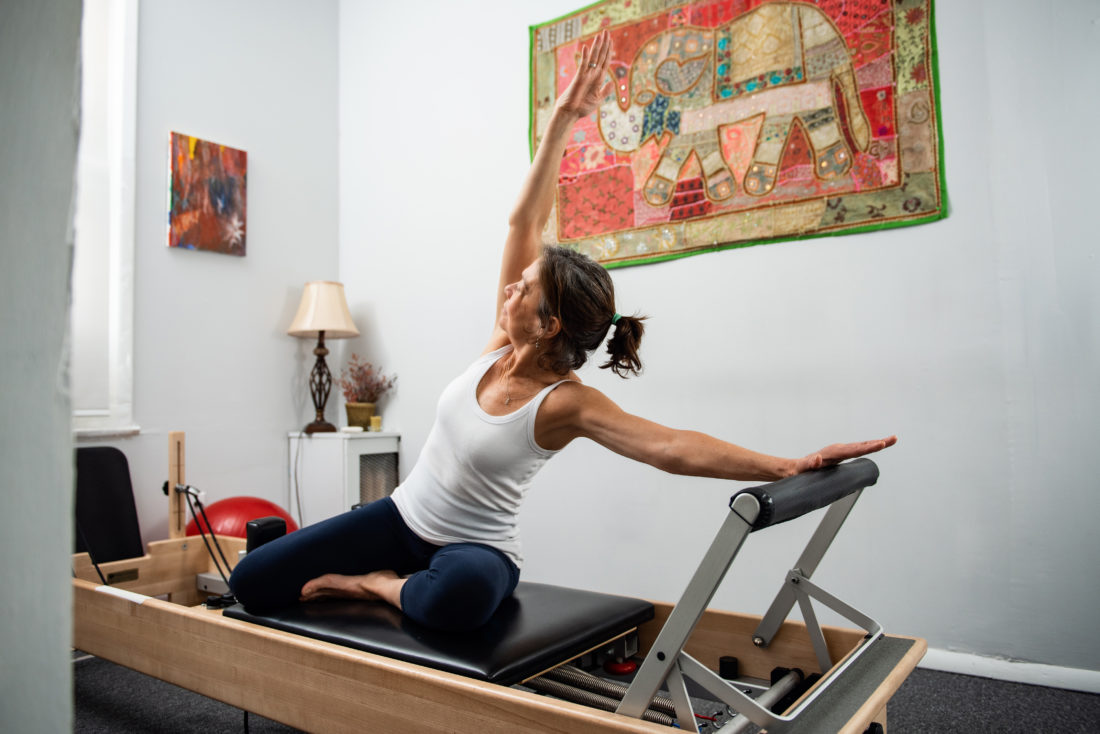 Juliana on the Pilates Reformer