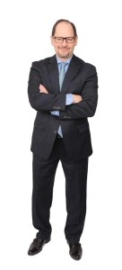 Full length portrait shot on white seamless backdrop of Lloyd Cooper, a top-performer with Cushman & Wakefield