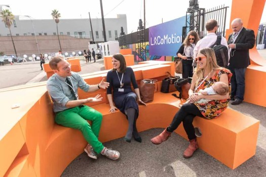 LACOMOTION-PEOPLE-LAUGHING-ON-ORANGE-TEMPORARY-FURNITURE