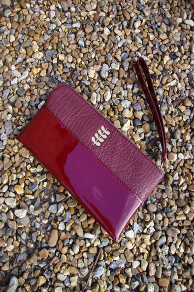 Orla Kiely plum leather/patent leather purse with wrist strap