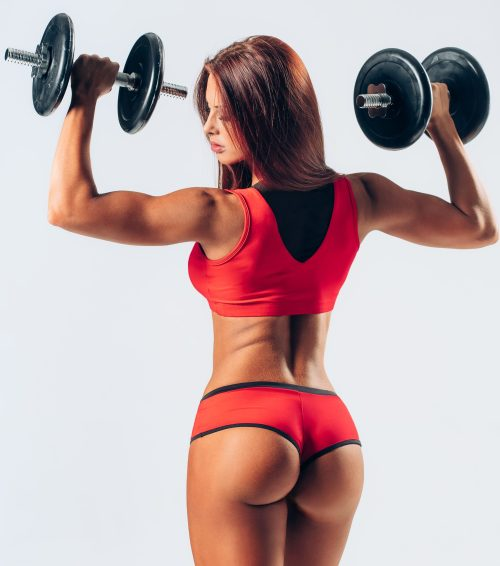 fitness women with barbells in red clothes