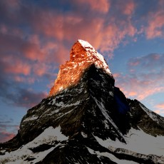 mountain with light at the top