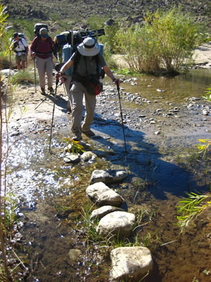 Hikers crossing the stream