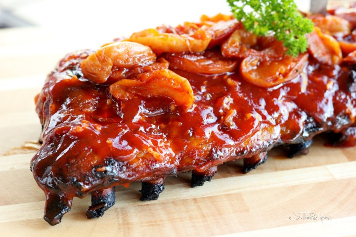 apple smoked pork ribs on wooden plank