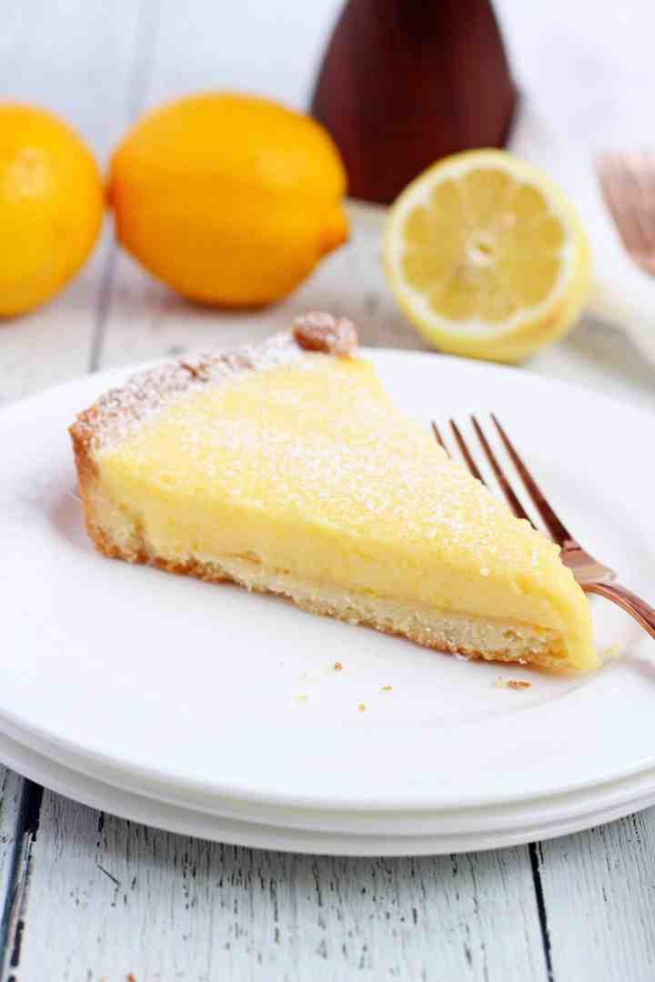Lemon tart slice on two white plates