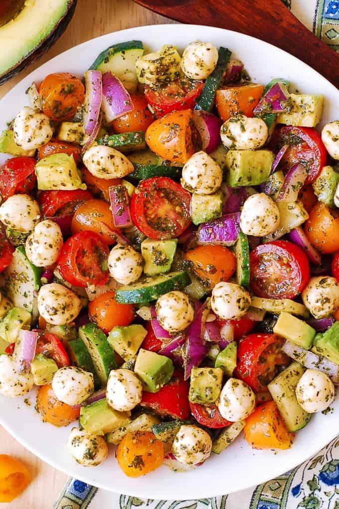 16. Tomato Cucumber Salad with Avocado, Mozzarella, and Basil Pesto