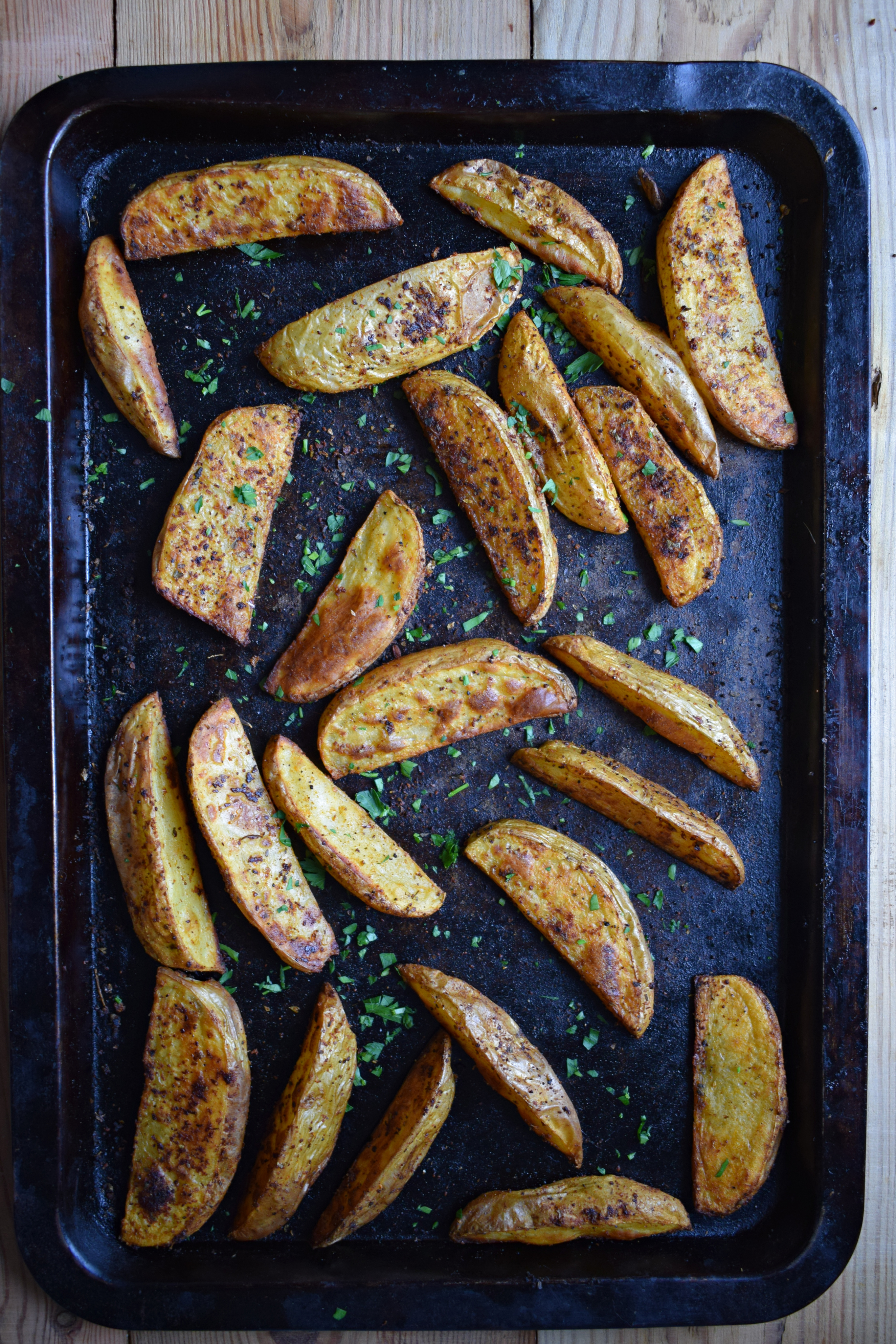 Paprika Spiced Potato Wedges on a baking tray