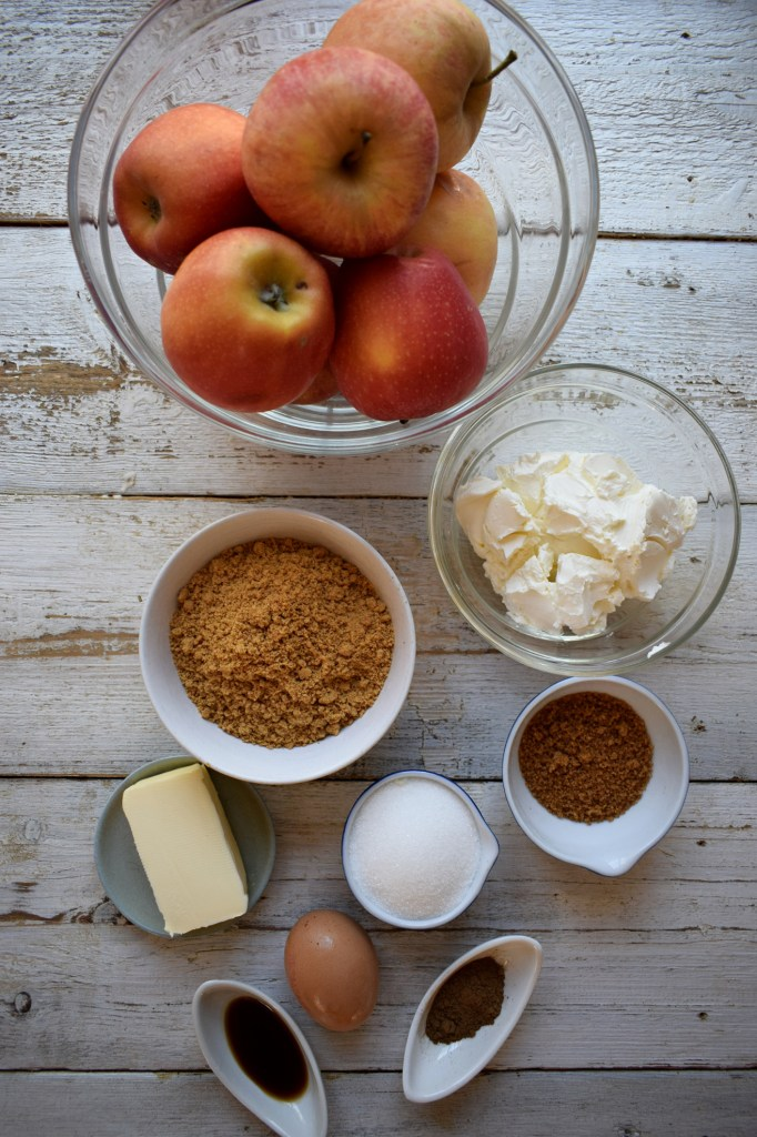 INGREDIENTS IN BOWLS TO MAKE CHEESECAKES