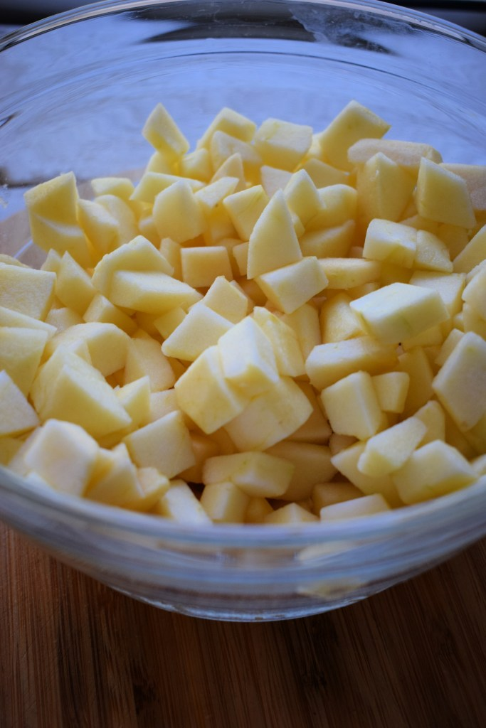 a bowl of diced apples