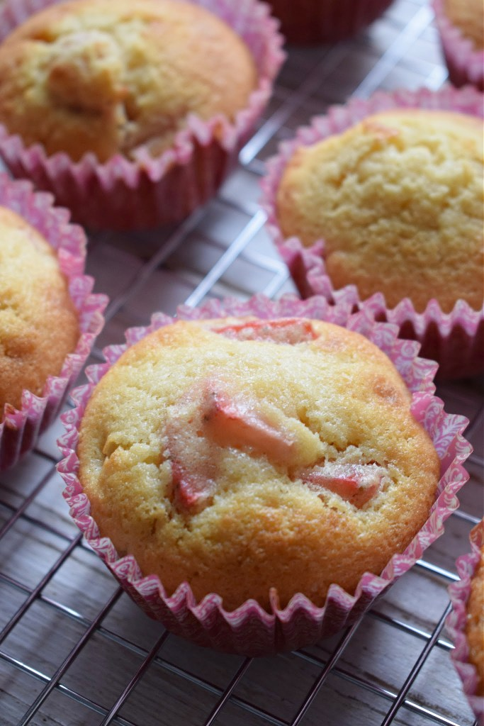 Fresh baked Strawberry cupcakes on a cooling rack
