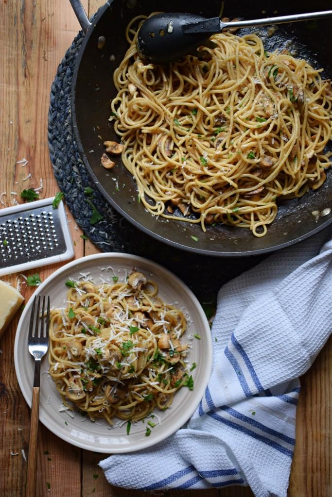 Garlic mushroom pasta on a table image