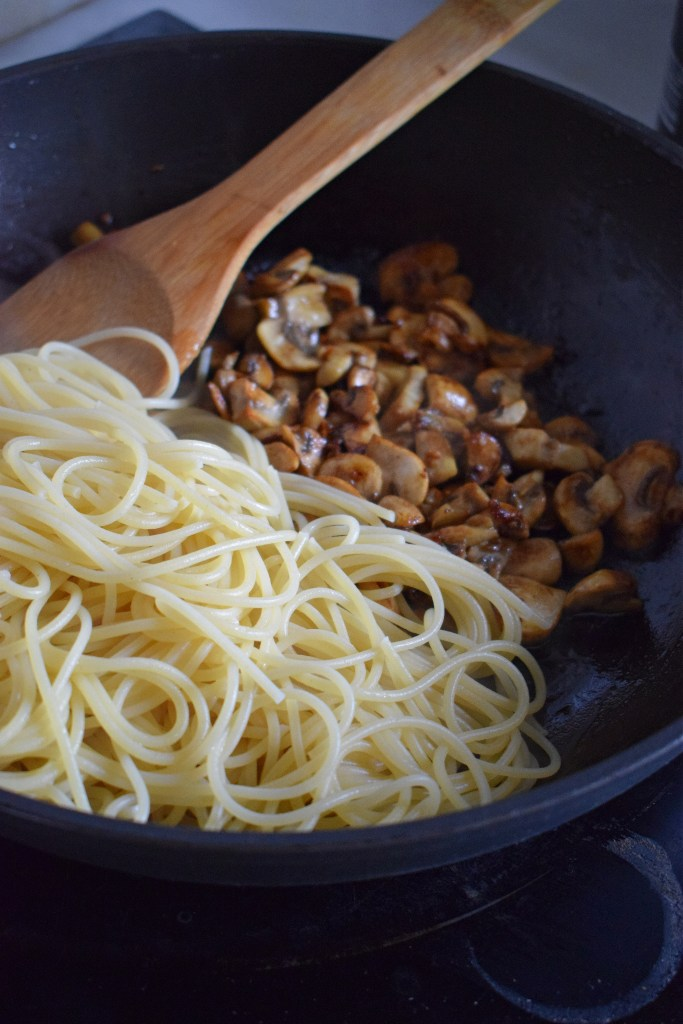 Spaghetti and mushrooms in a skillet