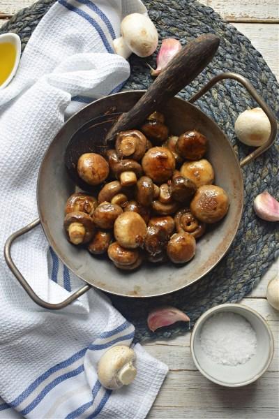 over head veiw of the garlic mushrooms with a tea towel