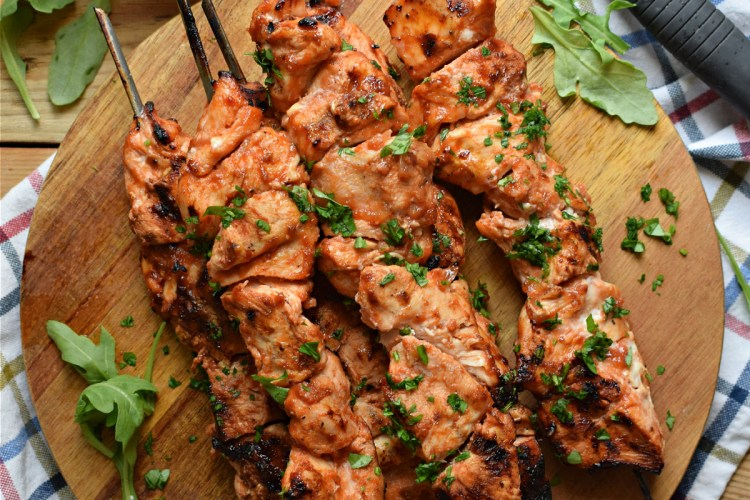 over head table view of the grilled barbecue chicken skewers