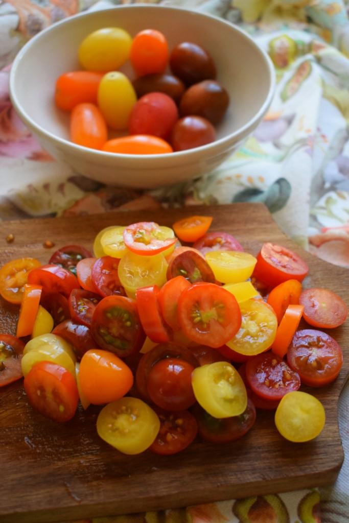 sliced up cherry tomatoes to make the  ricotta and tomato toast
