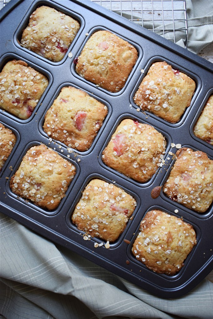 strawberry and apple muffins in a baking tray