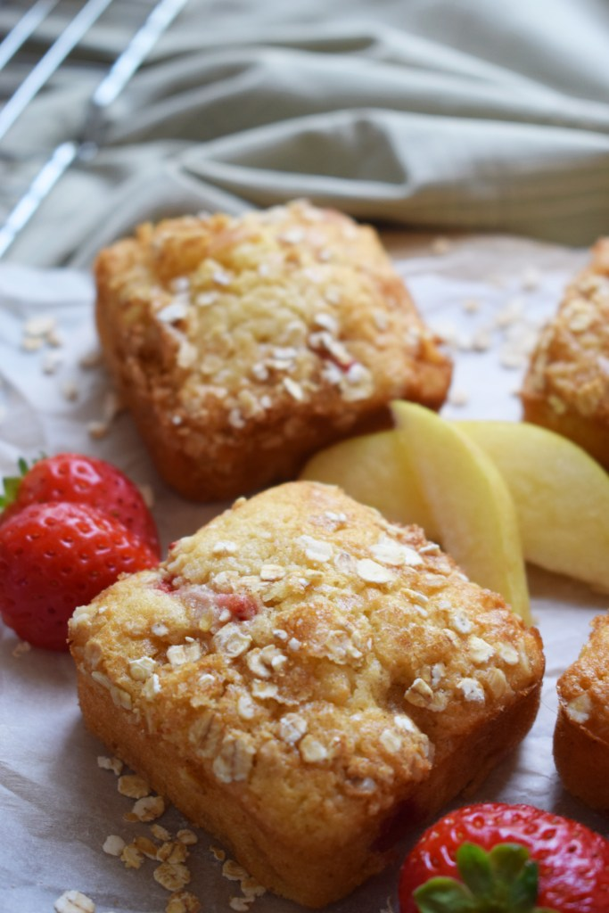 strawberry and apple muffins on a tray