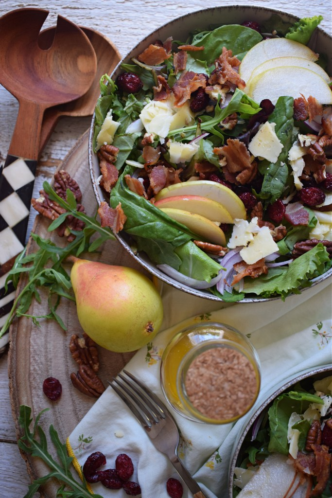 over head view of the pear and pecan salad with cheddar cheese and romaine lettuce