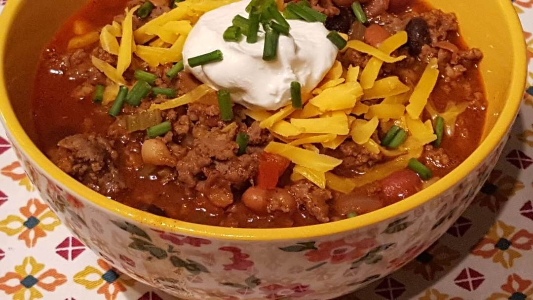 Chili Con Carne in a yellow bowl