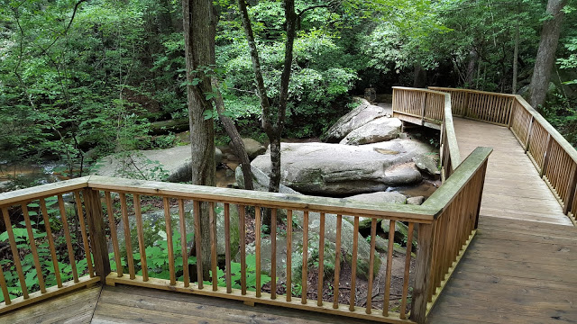Wooden deck walking path to trail in Table Rock state park in Pickens country South Carolina - hiking