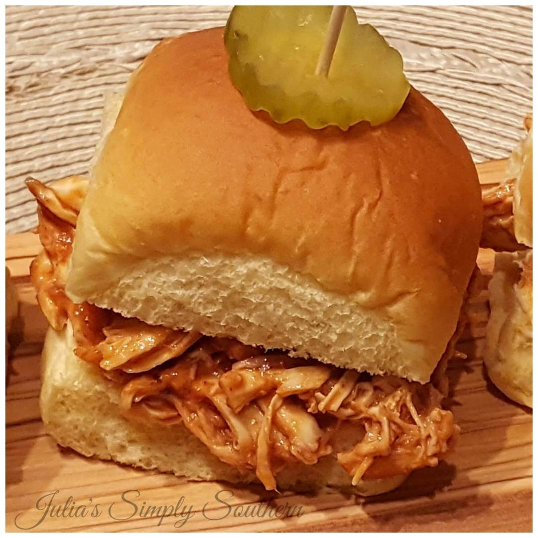 Barbecue Chicken Slider Sandwiches with a pickle served as appetizers or a meal