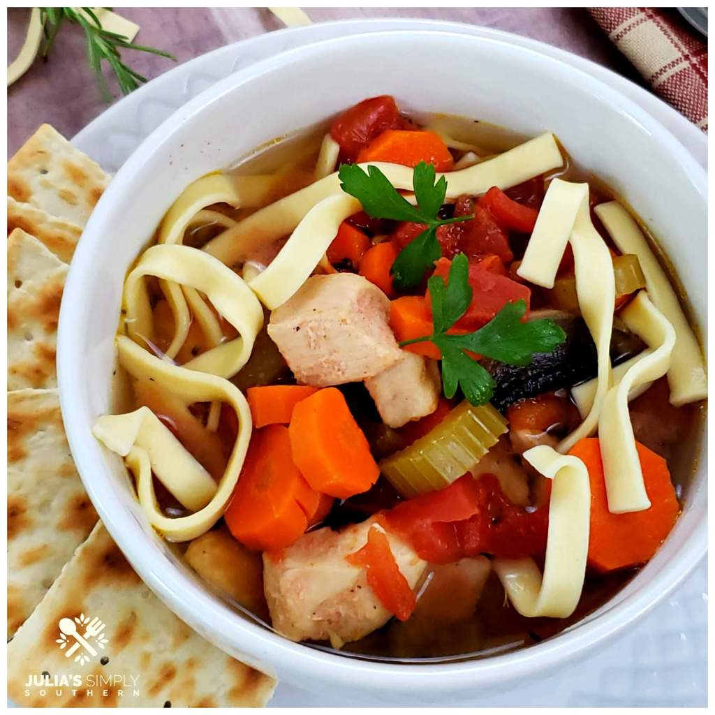 White bowl with slow cooker chicken soup - Best Southern food blog recipes