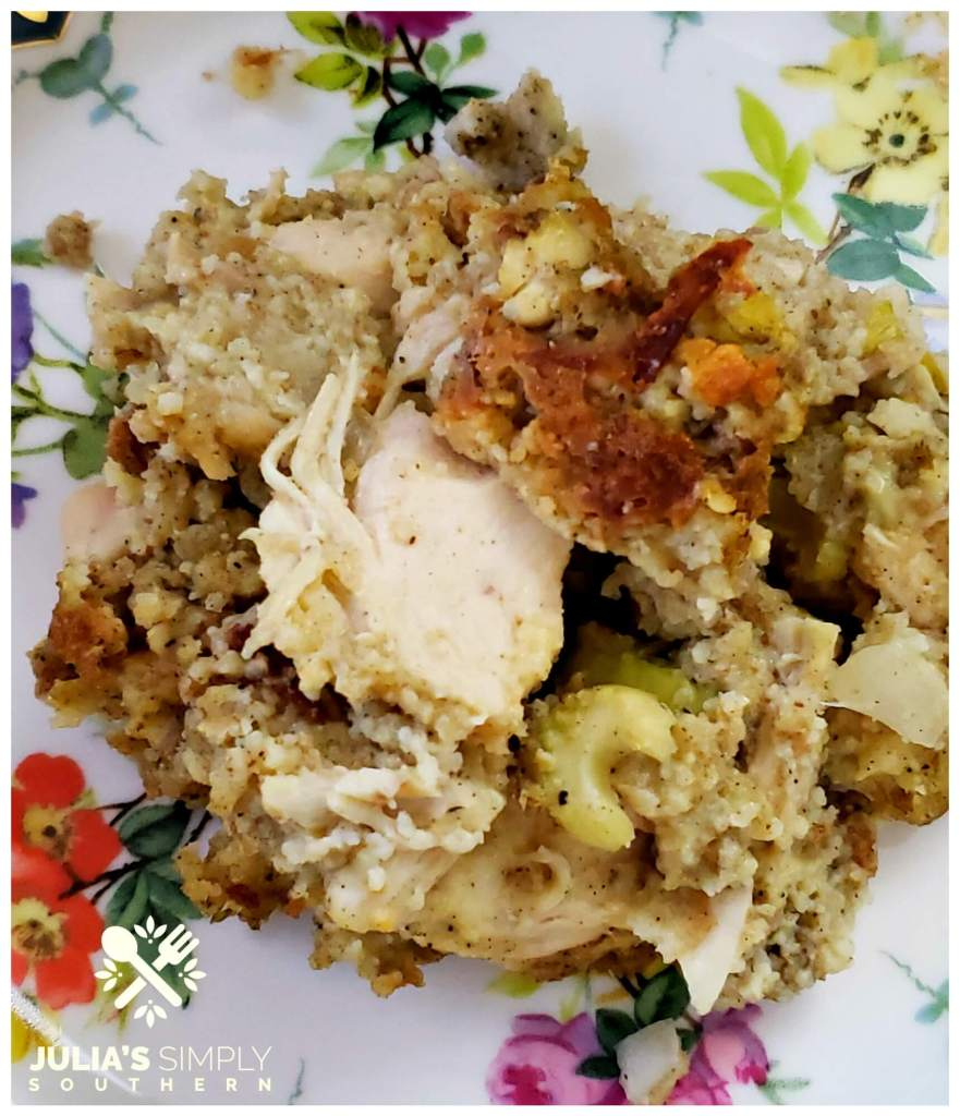 slow cooker chicken and cornbread dressing casserole recipe served on a pretty floral china plate