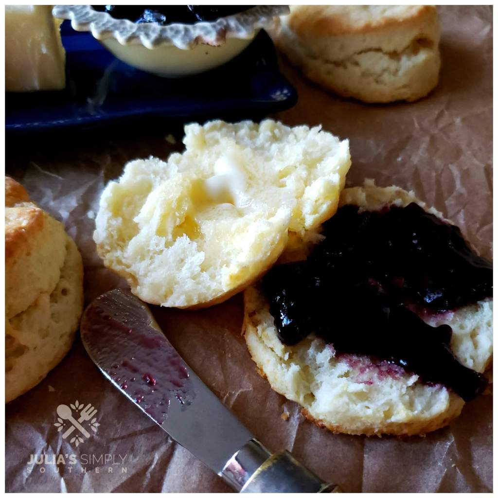 Blackberry jam on a cream biscuit