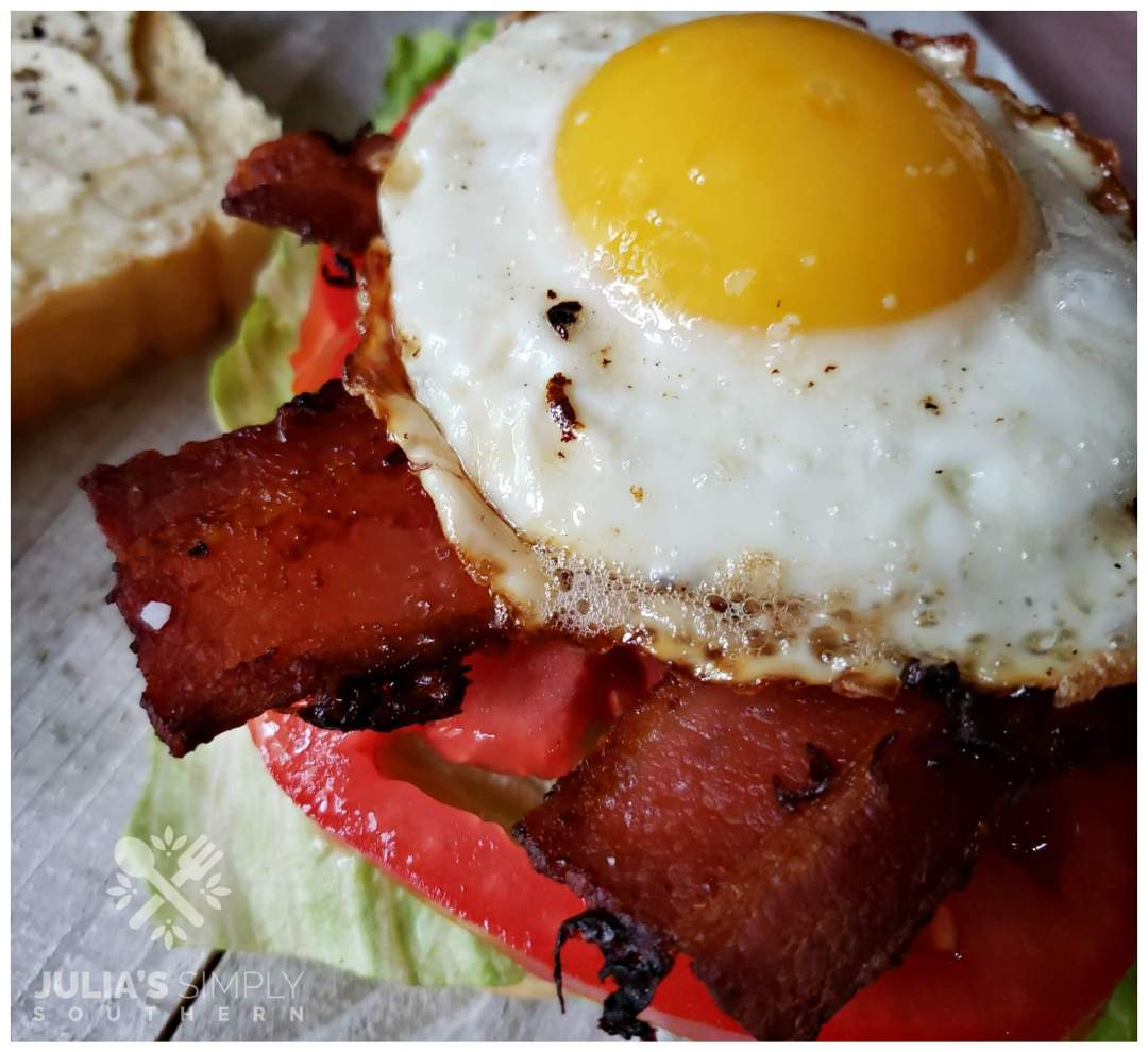 Ultimate bacon, lettuce and tomato with egg and cheese sandwich.