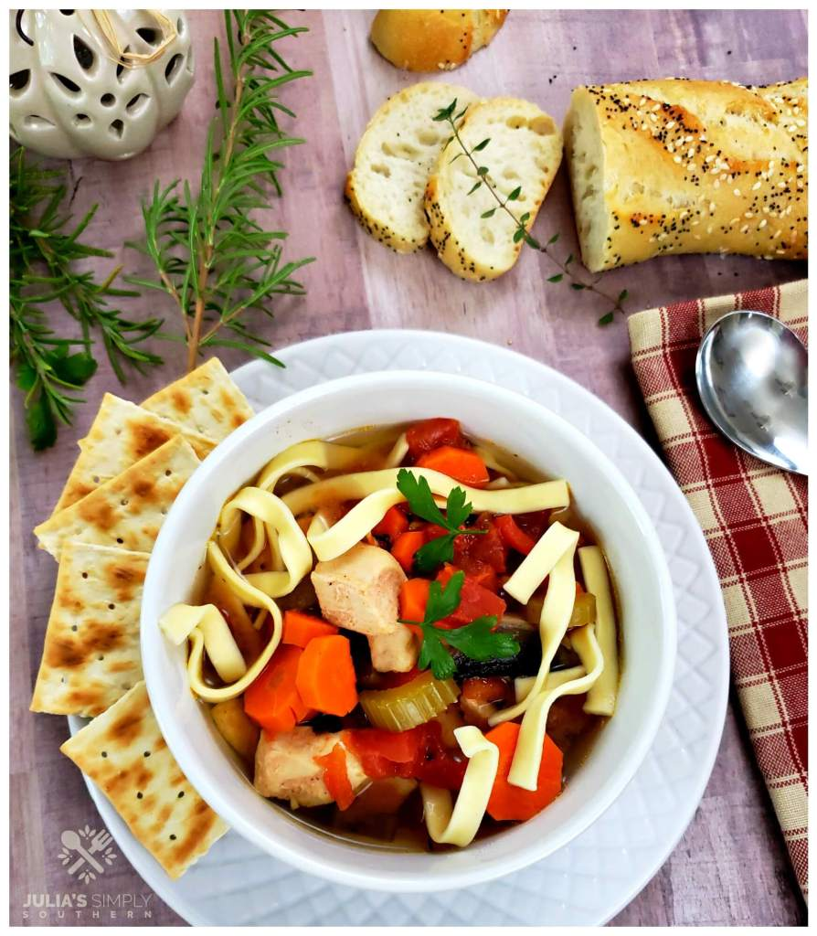 Best chicken noodle soup from the Crockpot with crackers and bread