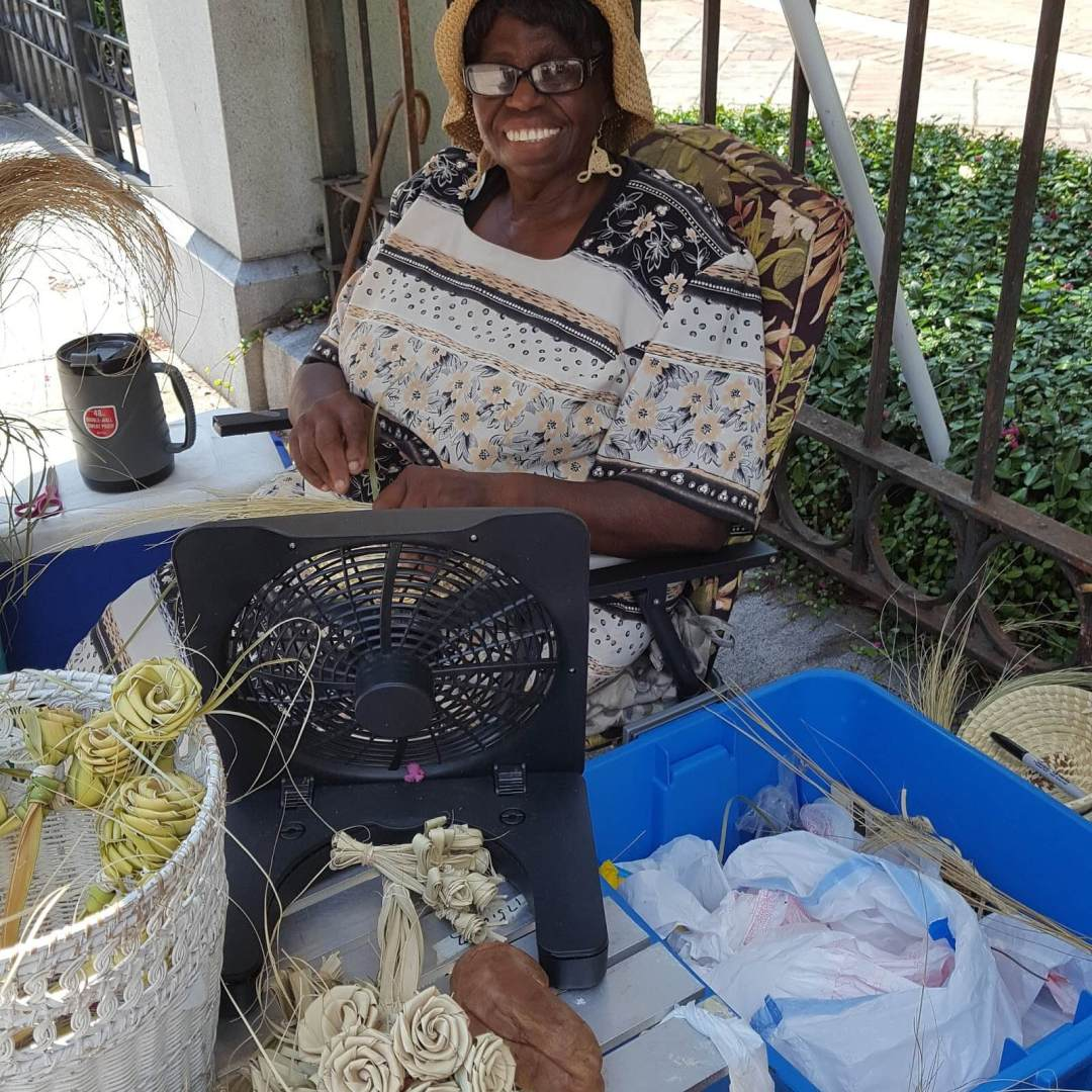 Ruth, local sweet grass basket maker in downtown Charleston