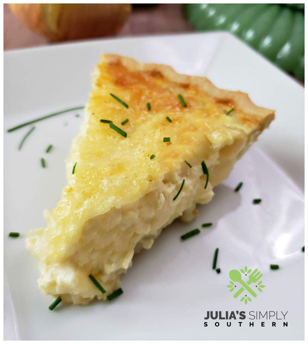 Creamy onion pie (quiche) made with Vidalia onions from Georgia and Swiss cheese on a white square plate.