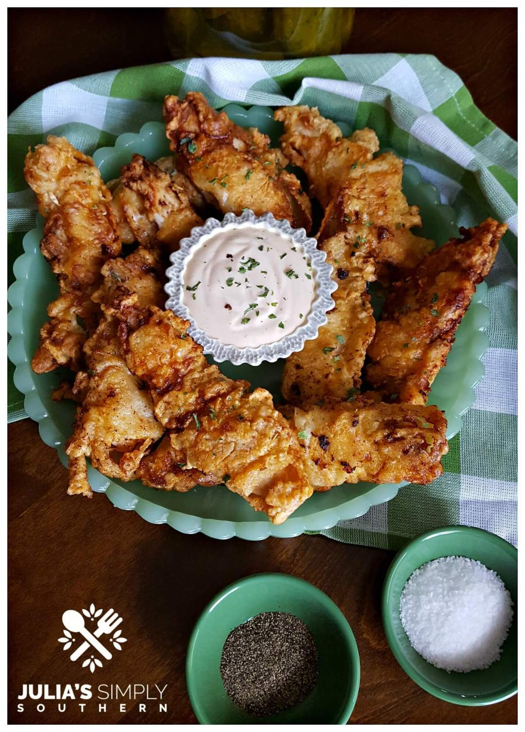Delicious and flavorful dill pickle fried chicken breast tenders served on green jadeite glassware