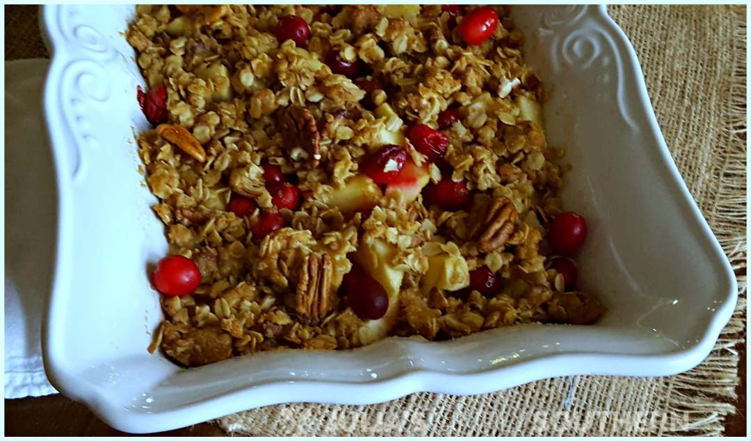 Southern Cranberry Apple Casserole dessert in a white baking dish. A delicious dessert for Christmas or a Southern new year dinner dessert