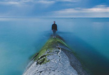 man alone on a breakwater
