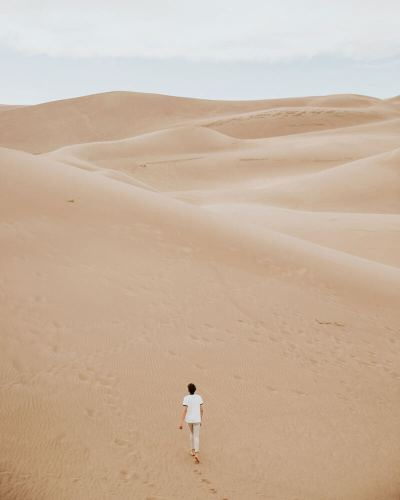 woman walking in the desert