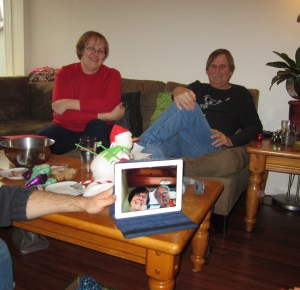 Both sets of grand-parents watching the opening of presents