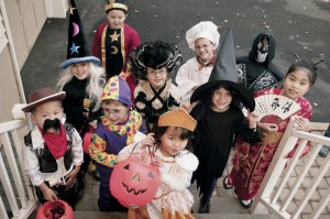 children trick or treating beggars night