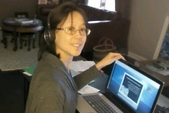 julia wearing a headset for a podcast