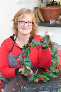 How to make a Christmas door wreath using a coat hanger