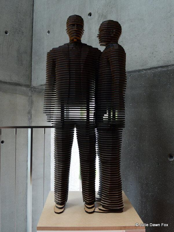 Two male figures made from sliced wood