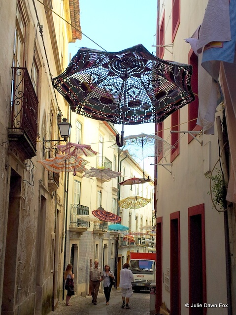 Crochet umbrellas decorating the old streets of Coimbra