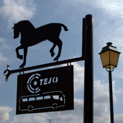 Horse-topped metal bus stop sign in Golegã, Portugal. Photography by Julie Dawn Fox