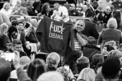 A Donald Trump fan holds and anti-Obama tee-shirt up at a campaign rally in Baton Rouge, LA, for Republican presidential candidate Donald Trump, before he arrives.