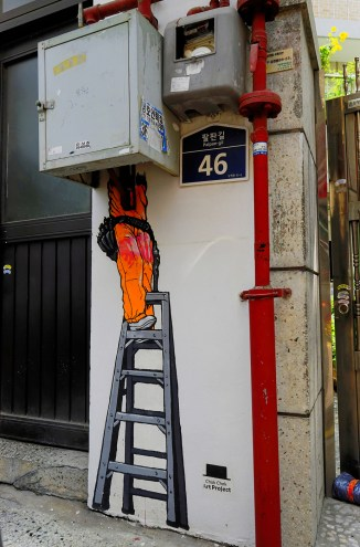 picture of a graffiti representing an electrician in Bukchon, Seoul, Korea