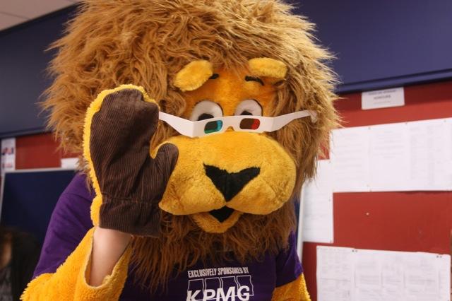 A KPMG maskot wearing anaglyph glasses