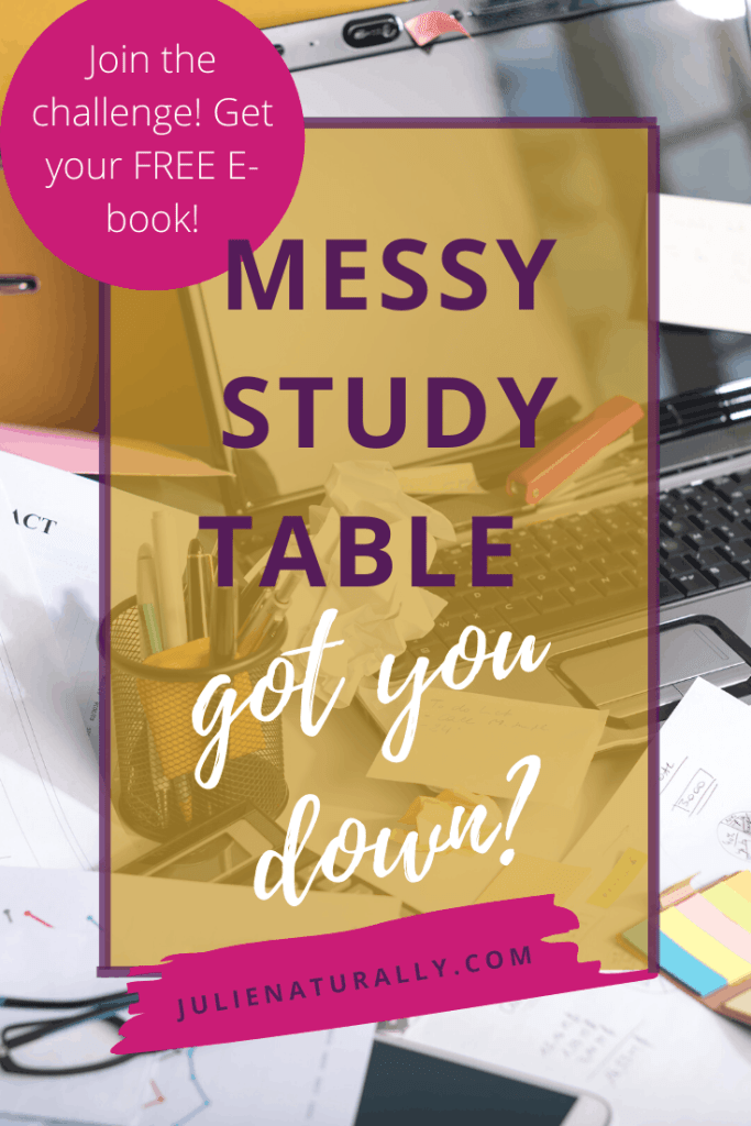 a messy study table with papers, books, computer, and writing instruments strewn all over