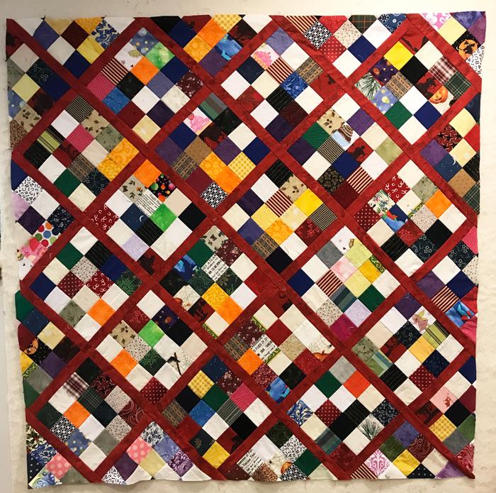 Scrap quilt, on-point postage stamp blocks